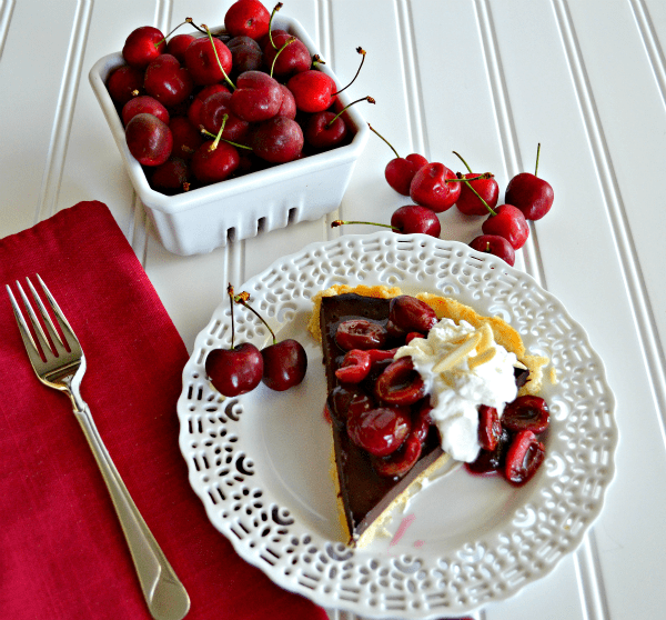 This Chocolate Cherry Tart with Almond Whipped Cream is the perfect treat for any chocolate lover in your life!