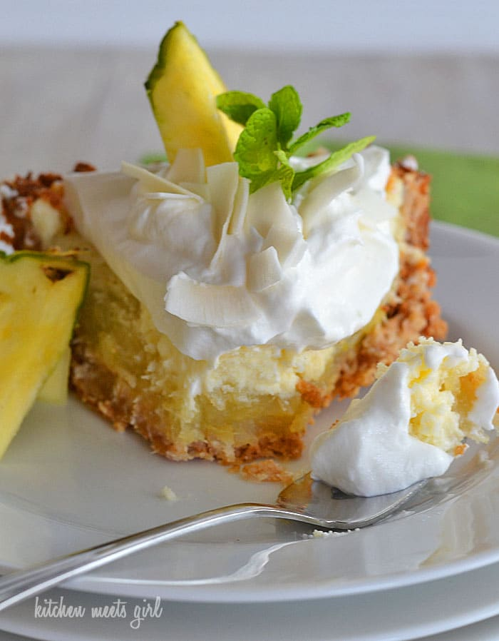 Pina Colada Icebox Pie on www.kitchenmeetsgirl.com - a three-layer pineapple, coconut, and cream pie!  So good!  #recipe #pie