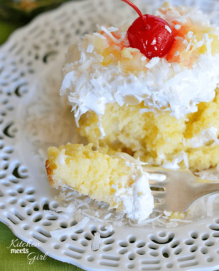 Pina Colada Poke Cake from www.kitchenmeetsgirl.com - so SIMPLE to make and absolutely DELICIOUS! #recipe #cake #pineapple #coconut