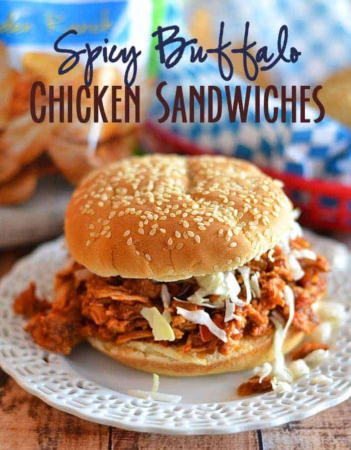 Simmered in a tangy sauce, this tender, spicy chicken is perfect on sandwiches, in tacos, or on a salad! #recipe #chicken #slow cooker