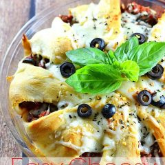 Need dinner on the table in 30 minutes or less? The whole family will love this easy cheesy pizza bake! Get the recipe at www.kitchenmeetsgirl.com! #recipe #pizza #crescent rolls