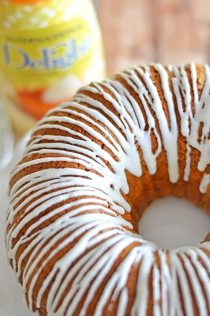 Pumpkin Spice Bundt Cake - adding pumpkin puree and evaporated milk is an easy way to jazz up a plain old spice cake mix! Comes together in a flash and tastes like homemade!