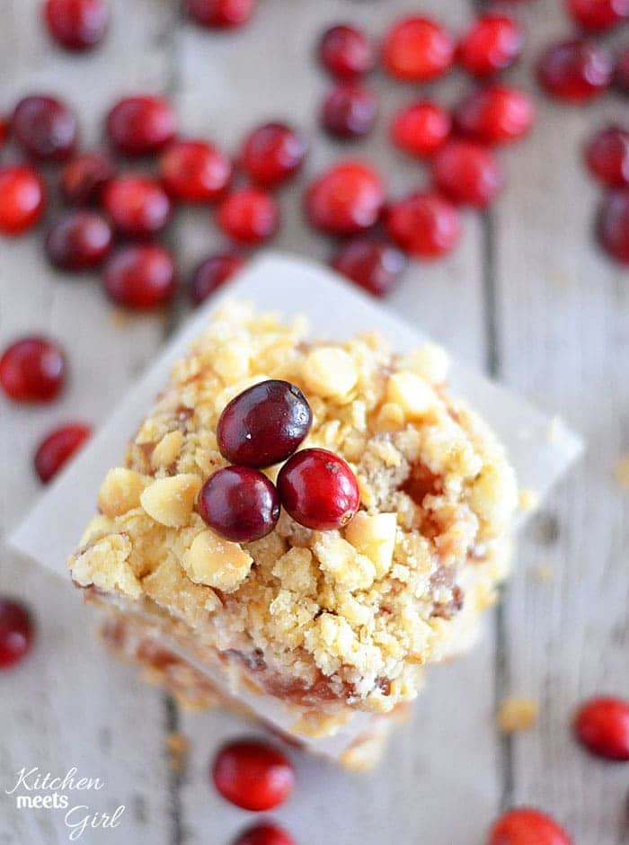 White chocolate, cream cheese, and pie filling are the perfect combination in these easy to make Apple Cranberry Cheesecake Bars.