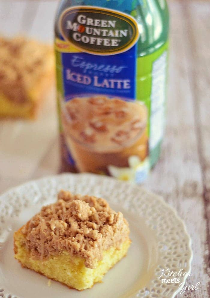 This New York Style Crumb Cake is tender, fluffy and buttery, and topped with a thick, spiced crumb topping and a vanilla latte glaze. #GMIcedLatte