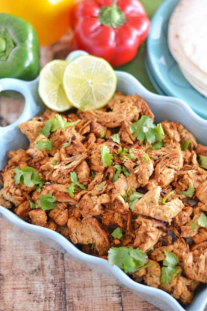 Jazz up your weeknights with this quick and easy Mexican Shredded Chicken - eat it plain, with beans or rice, or use it as a base for any Mexican-inspired meal!