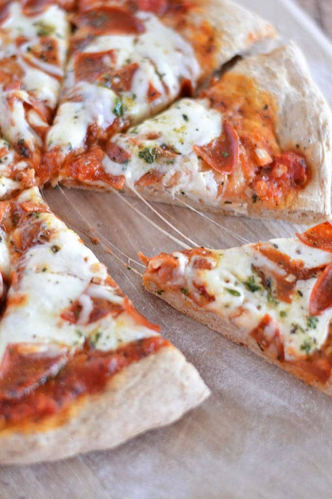 This Homemade Whole Wheat Pizza Crust is my family's favorite: it has a great nutty flavor, and bakes up soft and chewy - better than anything at any pizzeria!