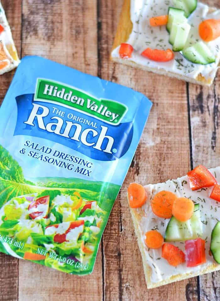 This easy Veggie Ranch Snack Pizza is a breeze to put together, is always a crowd-pleaser, and will get even the kiddos to eat their veggies!