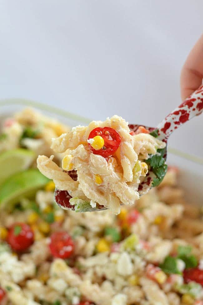 Packed with veggies and covered with a dressing made with Greek yogurt, this Creamy Cilantro-Lime Pasta Salad is the perfect addition to your summer cookouts.