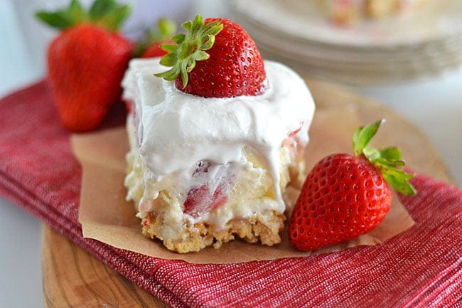With layers of cream cheese, Cool Whip, cheesecake pudding and fresh strawberries, this Strawberry Cheesecake Lushwill quickly become your new favorite summer dessert!