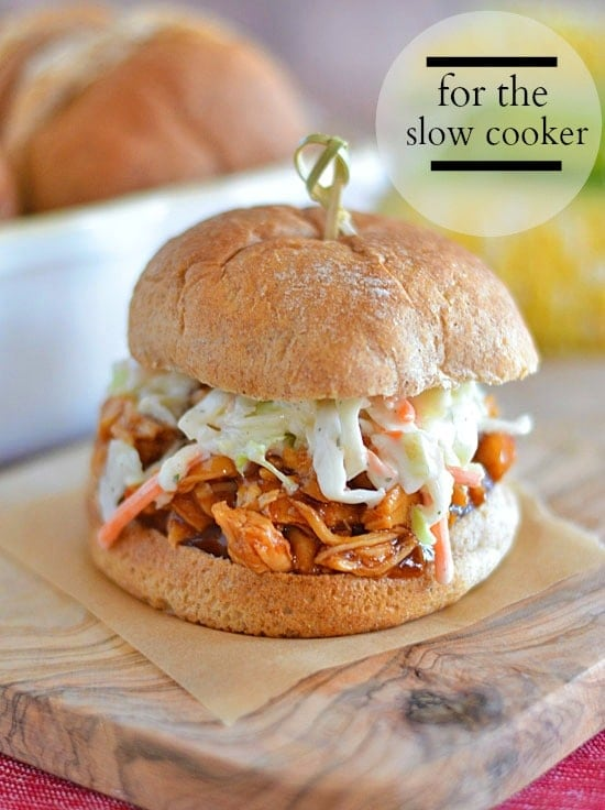 Dinner is no problem with these easy Honey BBQ Chicken Sandwiches topped with Ranch Slaw. Just a few ingredients and a slow cooker is all you need for this family friendly meal!