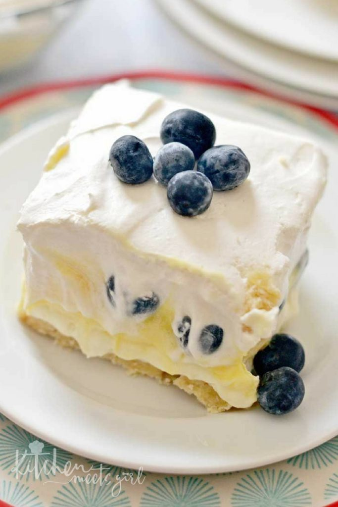 This Blueberry Cheesecake Lush is a quick and simple dessert recipe for your spring and summer get-togethers.  Layers of cream cheese, Cool Whip, pudding and fresh fruit make this a breeze to assemble!