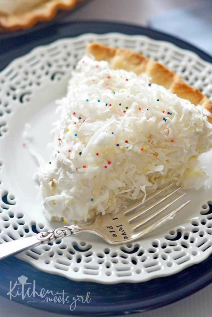 This Fluffy Coconut Cream Pie is simply divine! The custard filling is rich andsmooth, and using coconut milk and coconut extract gives it an extra creamy burst of coconut flavor. Topped with homemade whipped cream, this pie is a must make any time of the year.