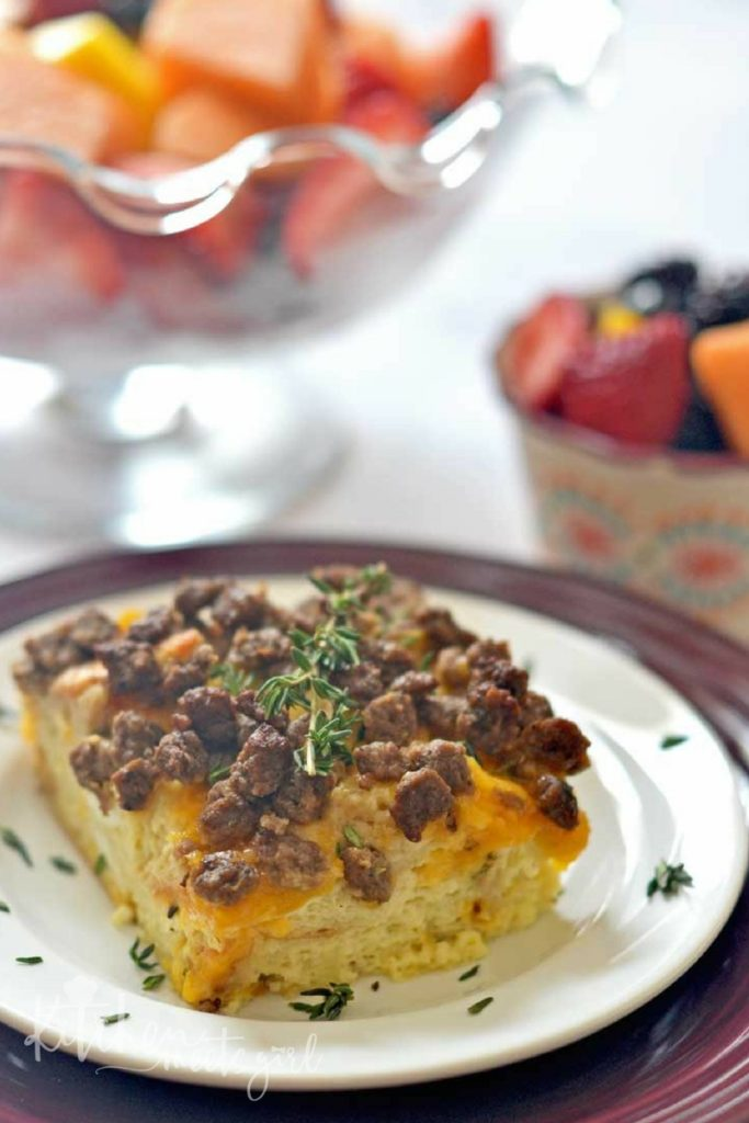 This Sunday Brunch Egg Casserole is the perfect cheesy, baked egg and sausage casserole for entertaining on the weekends - it's no fuss, filling, and always a crowd pleaser.